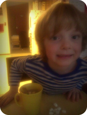 Carter with hot chocolate
