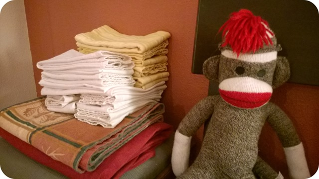 Sock Monkey folds the napkins